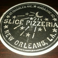 Photo taken at Slice Pizzeria by Kevie B. on 3/27/2012