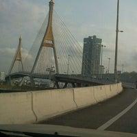 Photo taken at Bhumibol 1 Bridge by Yu T. on 2/28/2012