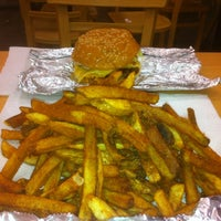 Photo taken at Five Guys by Kiran S. on 8/9/2012