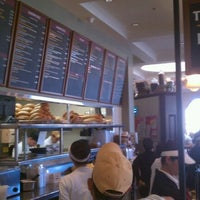 Photo taken at Porto's Bakery & Cafe by Carlton M. on 3/4/2012