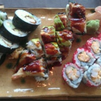 Photo taken at Hot Woks Cool Sushi by Emmy R. on 2/13/2012