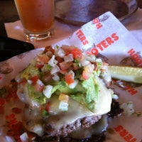 Photo taken at Hooters by Kool A. on 7/11/2012