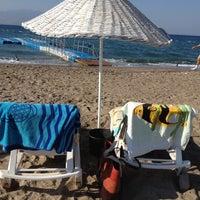 Photo taken at Hayat Bana Güzel Beach by Elif U. on 9/5/2012