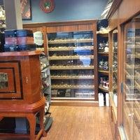 Photo taken at Fume Cigar Shop & Lounge by J. Carlos G. on 6/30/2012