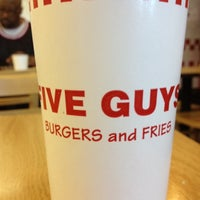 Photo taken at Five Guys by Eevee K. on 4/9/2012