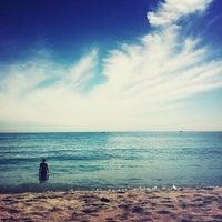 Photo taken at Bogatell Beach by Nastine on 9/3/2012