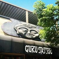 Photo taken at Guru Tattoo by Tara's Team on 8/29/2012