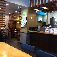 Photo taken at Starbucks by Lee S. on 7/15/2012