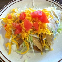 Photo taken at Mitla Cafe by Robert M. on 5/3/2012