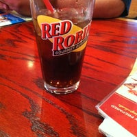 Photo taken at Red Robin Gourmet Burgers by Misty J. on 4/1/2012