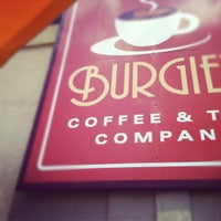 Photo taken at Burgie's Coffee & Tea Company by Gina K. on 7/9/2012
