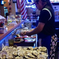 Photo taken at Deckhand Oyster Bar by Miriam R. on 5/19/2012