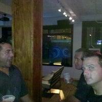 Photo taken at Aqua Restaurant & Bar by Christopher F. on 8/4/2012