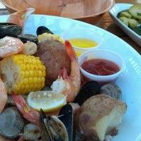 Photo taken at Coast Seafood & Raw Bar by Joe E. on 4/14/2012