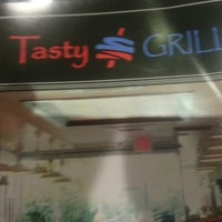 Photo taken at Tasty Grill by Victor B. on 7/25/2012