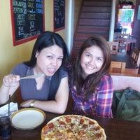 Photo taken at Handuraw Pizza by Wilghenson T. on 4/20/2012