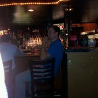 Photo taken at Satchmo's Bar & Grill by jason m. on 4/21/2012