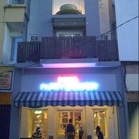 Photo taken at DE CAFÉ Resto & Delicatessen by Andy B. on 7/30/2012