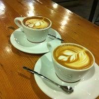 Photo taken at Intelligentsia Coffee & Tea by Carol L. on 4/20/2012