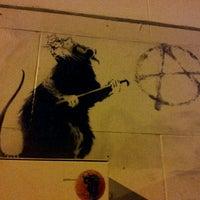 Photo taken at Banksy Mural: 'Glitter Glasses' Rat by Manixs M. on 3/16/2012