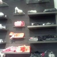 Photo taken at DSW Designer Shoe Warehouse by Keisha M. on 2/14/2012