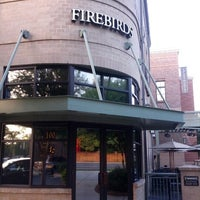 Photo taken at Firebirds Wood Fired Grill by Levi H. on 8/1/2012