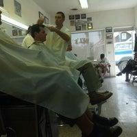 Photo taken at Del's Barber Shop by Tim C. on 4/6/2012
