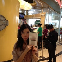 Photo taken at Krispy Kreme by Bow Y. on 3/13/2012