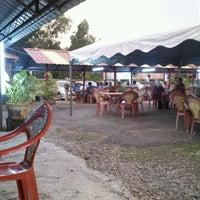 Photo taken at Pengkalan Ikan Bakar by Nuzul H. on 8/7/2012