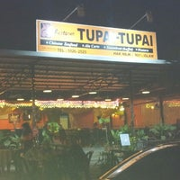 Photo taken at Tupai-Tupai Restaurant & Cafe by Domincie D. on 9/3/2012