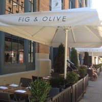 Photo taken at Fig & Olive by Kate Y. on 7/25/2012