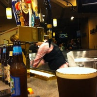 Photo taken at A-Bar Wine & Beer Lounge by Patrick Q. on 3/31/2012