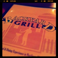 Photo taken at Backyard Grill & Bar by Ian W. on 3/1/2012