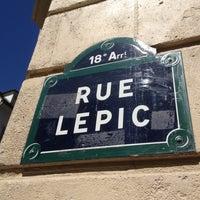 Photo taken at Le Moulin de la Galette by Thomas C. on 8/17/2012