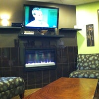 Photo taken at Bamboo Frozen Yogurt Café by Brandon T. on 5/29/2012