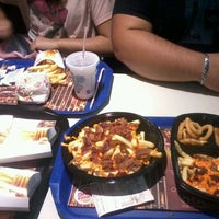 Photo taken at Burger King by Maria Luísa R. on 8/2/2012