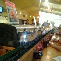 Photo taken at Sushi Train by Tammi S. on 3/31/2012