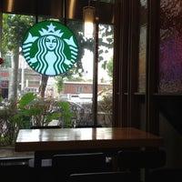 Photo taken at Starbucks by Gu M. on 7/28/2012