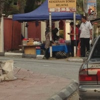 Photo taken at Nasi Lemak Bas Stand by Kenny W. on 6/26/2012