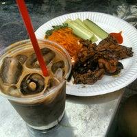 Photo taken at Ca Phe Vn's Saigon Street Cafe by Jonathan C. on 9/2/2012
