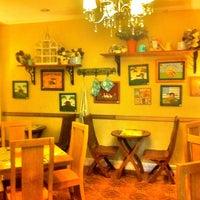 Photo taken at Simply J's Café & Restaurant by Benson S. on 7/18/2012