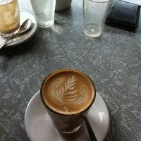 Photo taken at Feedback Cafe by Matt C. on 3/9/2012