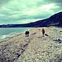 Photo taken at Charmouth Beach by Jonathan C. on 5/5/2012