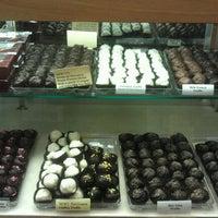 Photo taken at Paul Thomas Chocolates by Myra C. on 7/21/2012