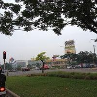 Photo taken at Perempatan Giant Hypermart - German Centre by Yudi H. on 6/13/2012