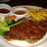 Photo taken at Outback Steakhouse by Anissa R. on 6/9/2012