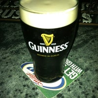 Photo taken at Mulligan's Irish Pub by Ryan B. on 3/23/2012