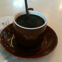 Photo taken at OldTown White Coffee by Amelia O. on 4/16/2012