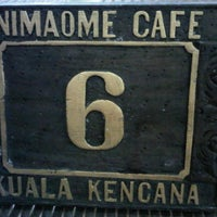 Photo taken at Nimaome Cafe by Deby S. on 3/7/2012