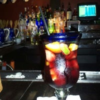 Photo taken at Ceviche Tapas Bar & Restaurant by Cowbell K. on 5/22/2012